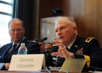 Air Force Gen. Craig R. McKinley, left, chief of the National Guard Bureau, listens as Army Maj. Gen. Raymond W. Carpenter, acting director of the Army National Guard, testifies before a March 24, 2010, hearing of the Senate Appropriations Committee's subcommittee on defense in Washington, D.C. U.S. Army photo by Staff Sgt. Jim Greenhill
