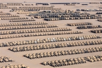 Thousands of vehicles and equipment that have returned from Iraq wait to be retrograded in a 3rd Army lot in Kuwait