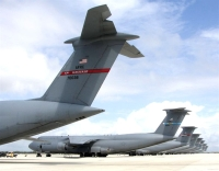 Air Force C-17 and C-5 transports sit on the flightline at Naval Station Rota, Spain