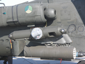 The small pod containing Northrop Grumman's laser Directional Infrared Countermeasures (DIRCM) system mounts to the end of the stub-wing on the Apache AH-64D attack helicopter. The system successfully thwarted a series of simulated heat-seeking missile attacks on a Dutch Apache helicopter in recent tests.