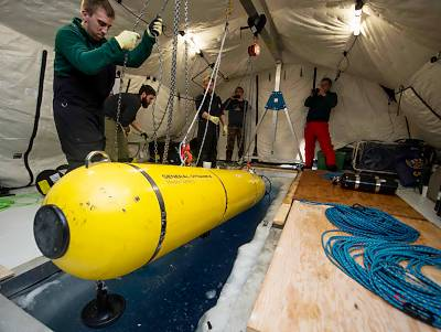 160314-N-QA919-369 ARCTIC CIRCLE (March 14, 2016) Students with MIT deploy the MACRURA Unmanned Underwater Vehicle during Ice Exercise (ICEX) 2016. ICEX 2016 is a five-week exercise designed to research, test, and evaluate operational capabilities in the region. ICEX 2016 allows the U.S. Navy to assess operational readiness in the Arctic, increase experience in the region, advance understanding of the Arctic environment, and develop partnerships and collaborative efforts. (U.S. Navy photo by Mass Communication Specialist 2nd Class Tyler Thompson)