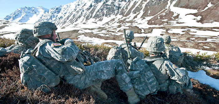 JOINT BASE ELMENDORF-RICHARDSON, Alaska – Soldiers of Comanche Company, 1st Battalion, 501st Infantry Regiment (Airborne), hide behind some cover before they assault the area below May 12. The Soldiers took part in air assault training where UH-60 Black Hawk helicopters took them into a section of Alaska's Chugach Range and they were tasked with engaging an opposing force. (U.S. Air Force photo/Senior Airman Christopher Gross)